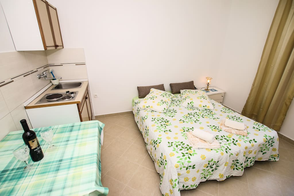 bed and kitchen