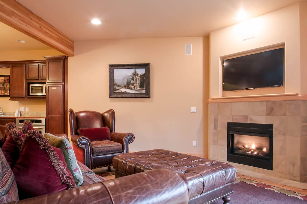 Lodge inspired living area with cozy gas fireplace