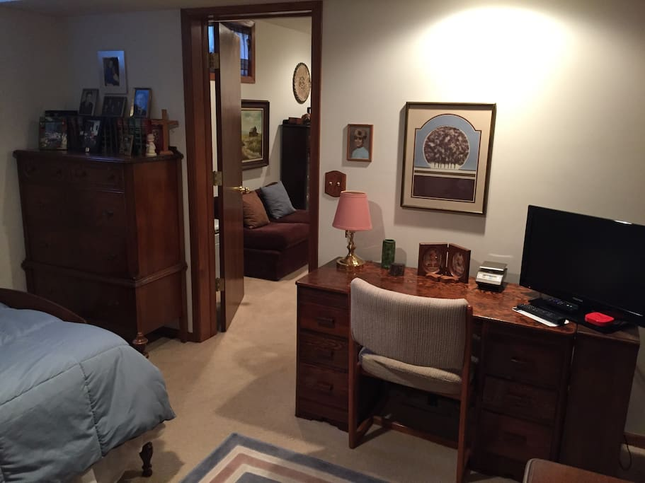 The writing desk in the Lower Level Bedroom with Cable TV & Netflix. Also a tall dresser for organizing clothes for those longer stays!