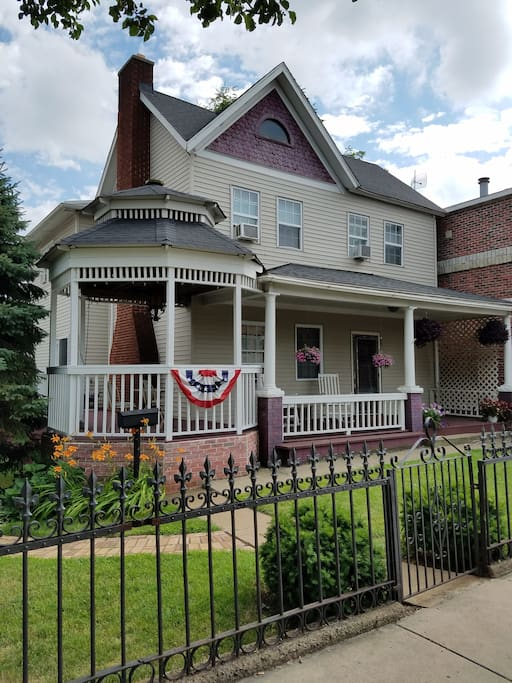 Beautiful front porch with relaxing rocking chairs.