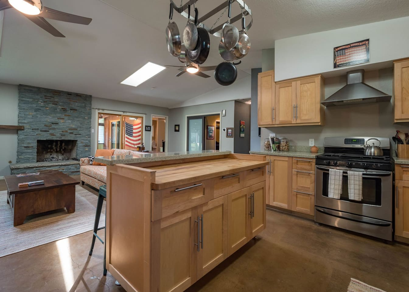 Open layout with updated appliances in the kitchen