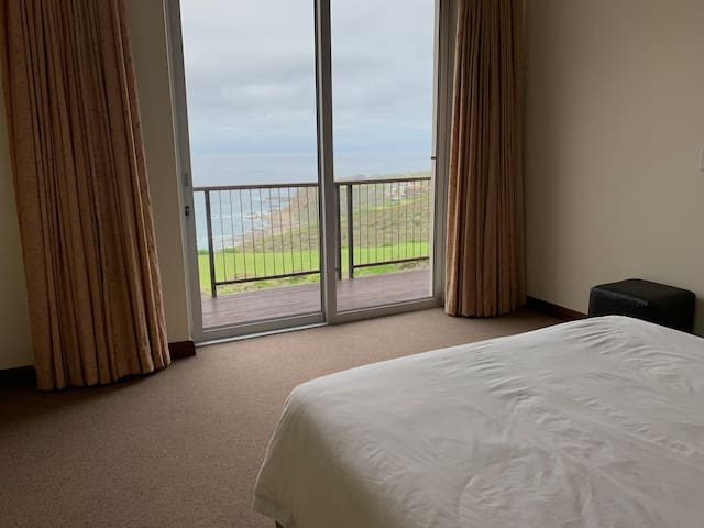 Typical view of fynbos, golf course, beach, waves and ocean from the (all en suite-) bedrooms