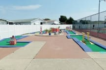The kids will LOVE this! A miniature golf course and a shuffle board area!