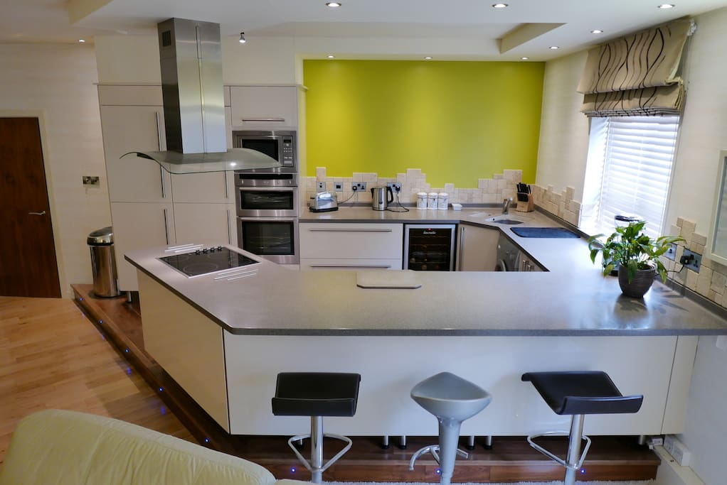 Fully fitted kitchen with breakfast bar.