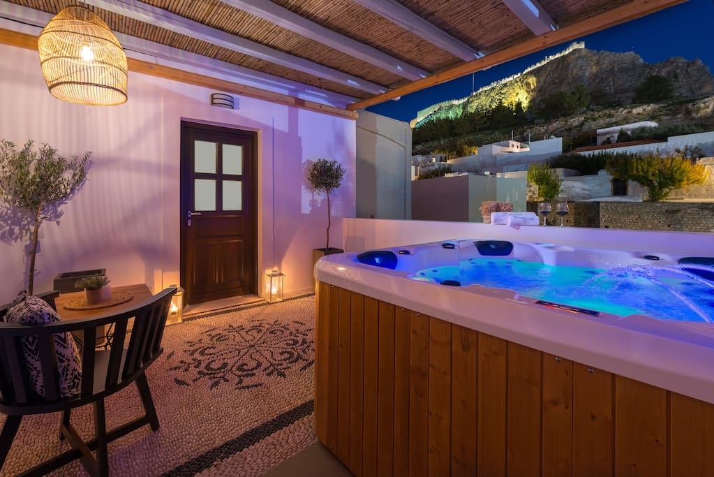 First floor Open Air 5 seat Jacuzzi. Under the Acropolis of Lindos with a view to the Ancient Amphitheater.