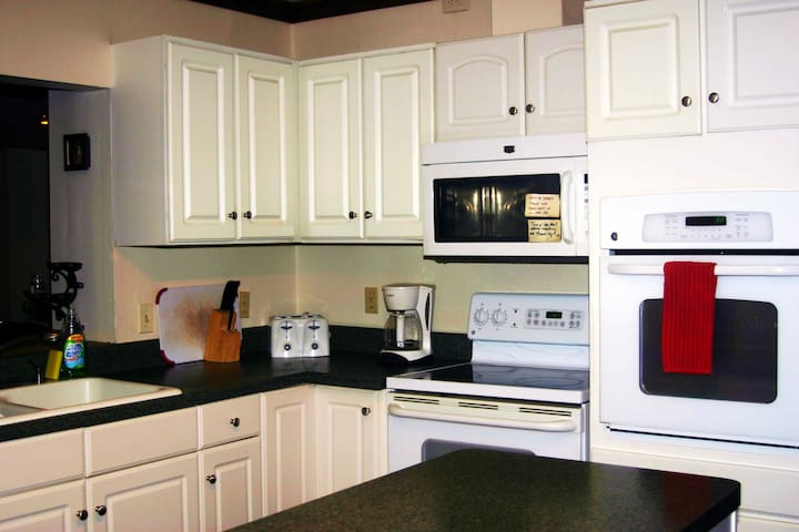 Remodeled Kitchen including two ovens, dishwasher, microwave, drip coffee maker and garbage disposal