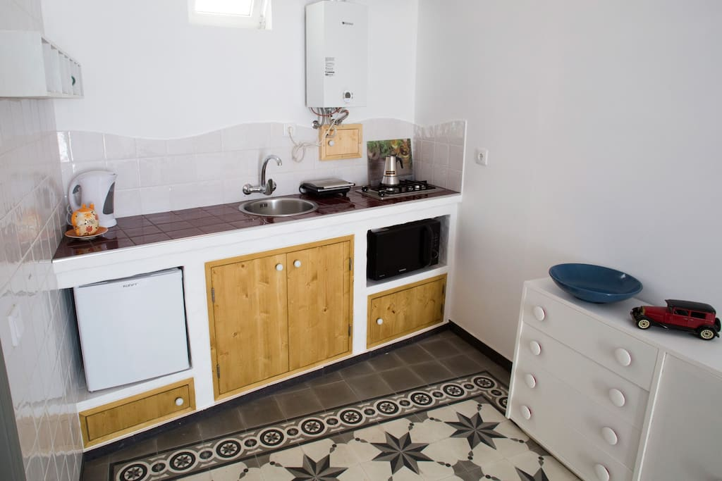 kitchen with refrigerator, microwave/oven, electric kettle, pannini grill and espresso coffee maker