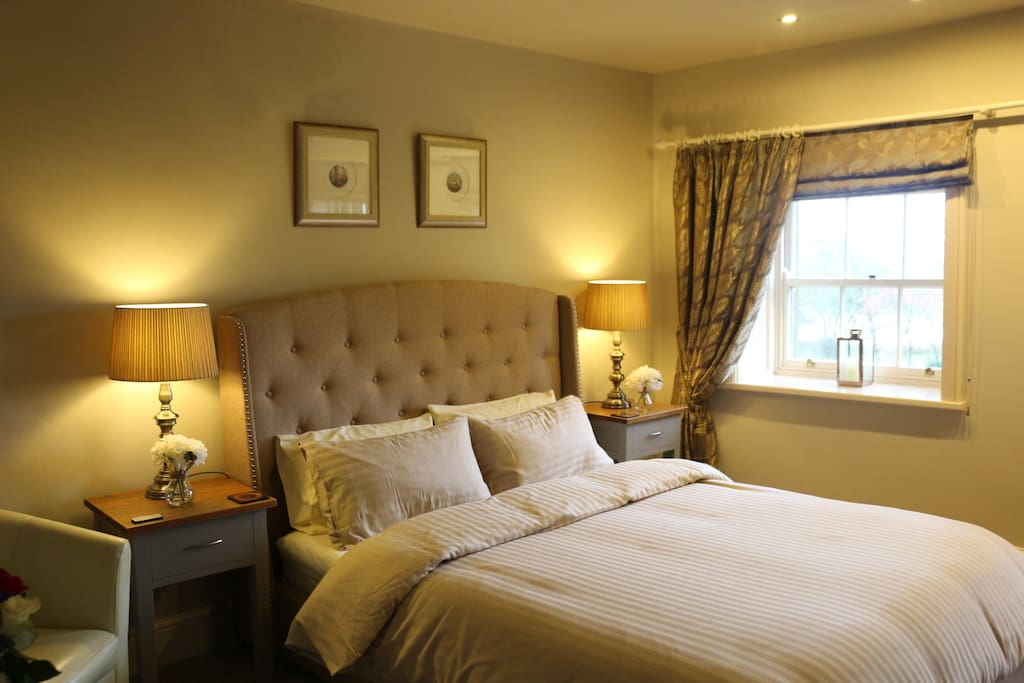 Newly furnished with a chesterfield bed, contemporary furnishings and two sash windows overlooking the  garden and lake