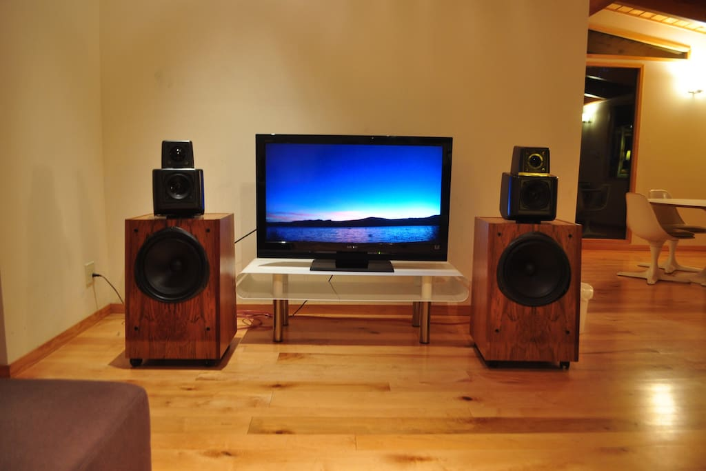 """A/V system with vintage KEF speakers, 42"""" TV, state of the art electronics with AppleTV, free NetFlix, and Bluetooth audio support."""