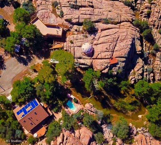 Aerial view of Heaven on Earth Retreat & Sanctuary with the Cave Castle, Golden Dome and Cliff Chalet