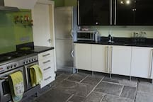 Kitchen with large fridge freezer, microwave and access to garage.