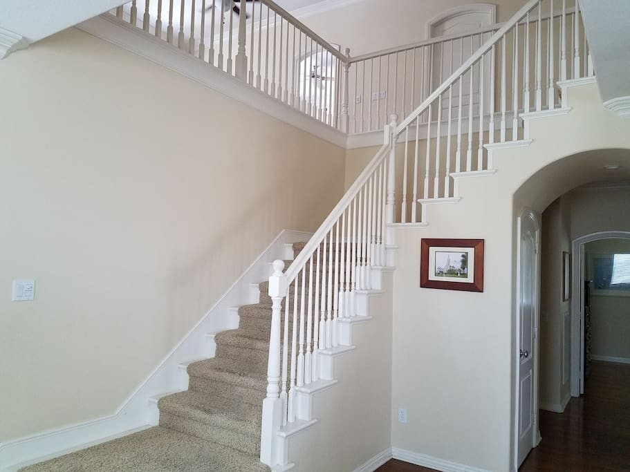 Up stairs off of the entry way.