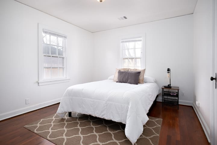 1st bedroom on main floor. Queen sized bed with comfy linens and pillows. Original hardwood floors throughout.