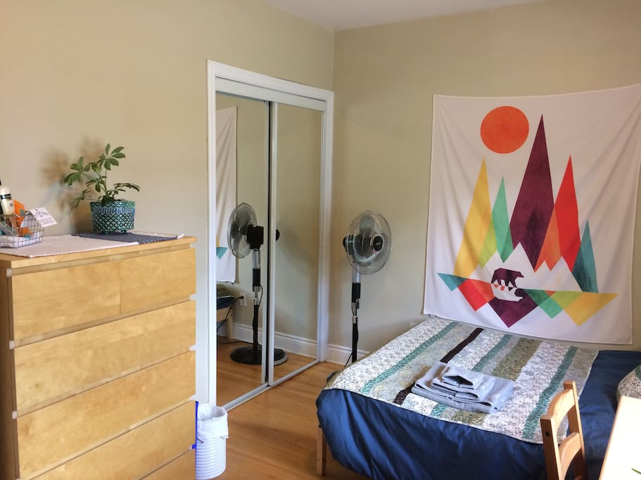 Double bed, large closet, and dresser. We have central air conditioning, and your room has a fan as well.