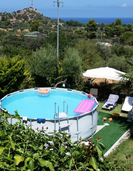 View from 1st floor, garden with the pool