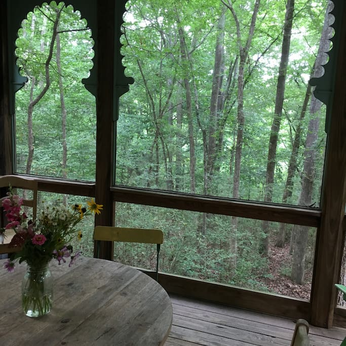 Porch overlooks a wooded valley