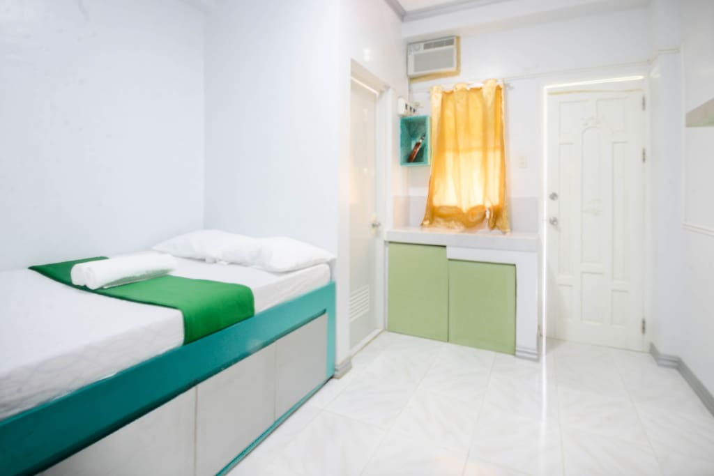 Guest room - each room is different colour but same style.