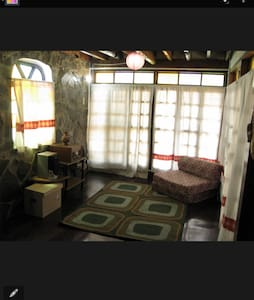 a cabin style home in a rural town - Angono - Bed & Breakfast