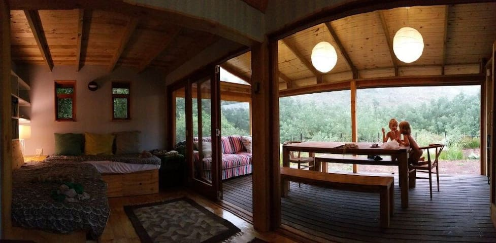 Sliding doors enclose the outside deck if the weather gets windy or chilly
