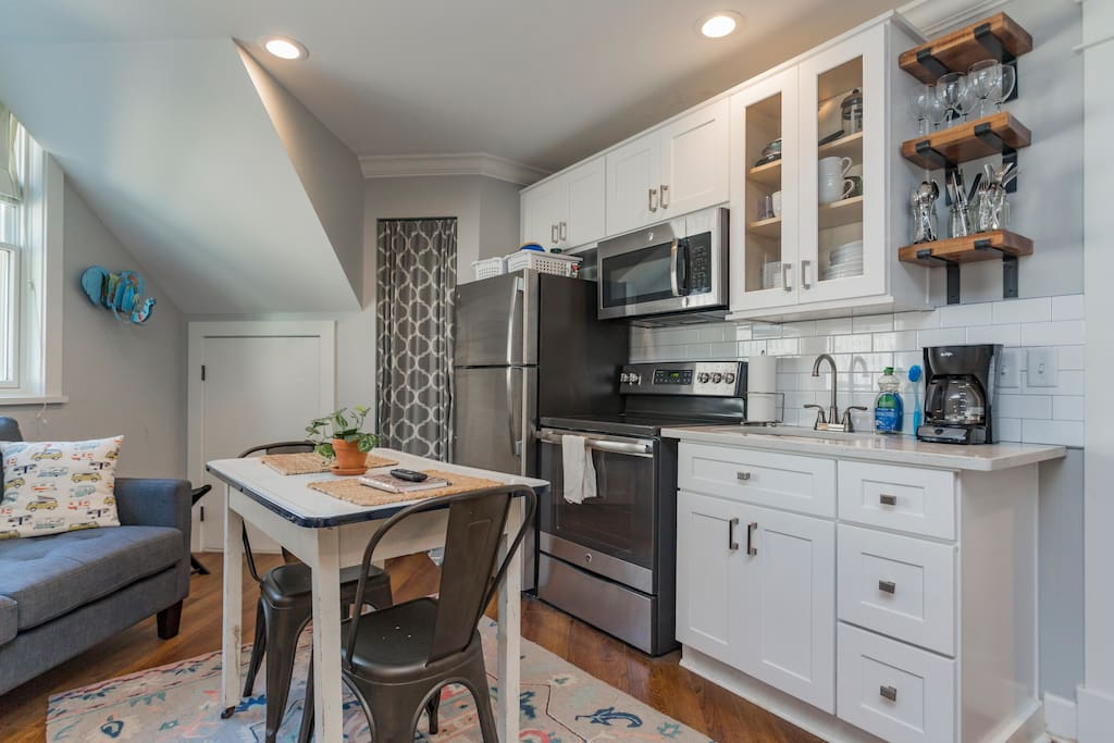 Kitchen includes full-size refrigerator and range, microwave, coffeepot and kettle, dishes, flatware, basic pots & pans and other kitchen essentials.