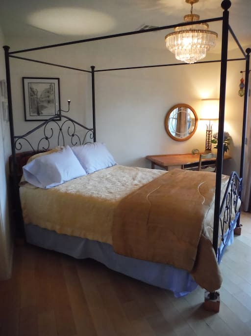 Queen bed with fresh sheets and comforter