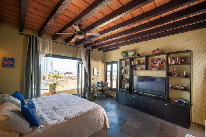 The master bedroom is a self-contained suite