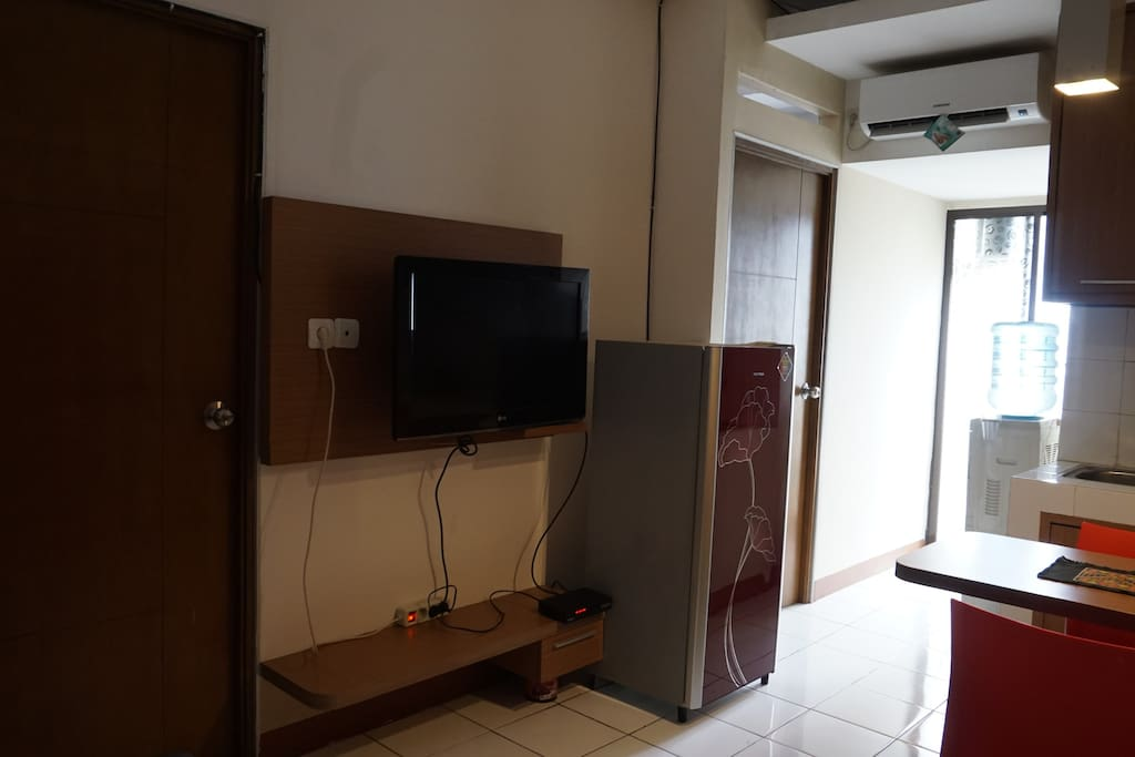 Living Room with Refrigerator, TV and AC