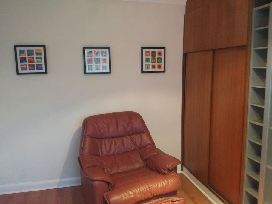 Room 1 - Comfy armchair and spacious wardrobe and shelves