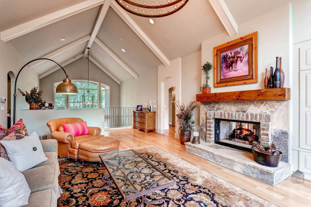 The upper level living area has lofted ceilings with a giant fireplace place that makes it decidedly comfy.