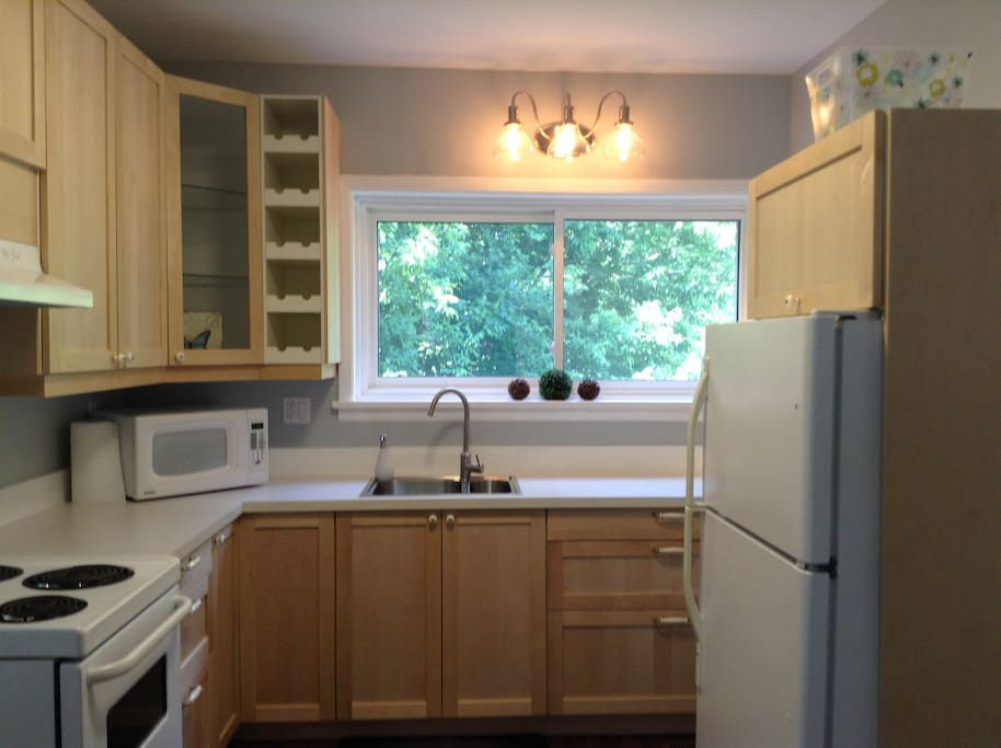 Newly renovated bright kitchen.  Contains everything you need to make your stay comfortable.