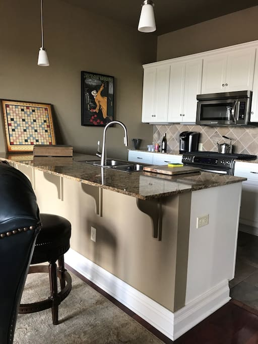 kitchen with island and two bar stools