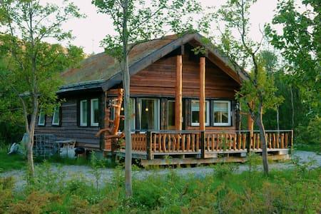 Cabin by the river at Storslett, Nordreisa