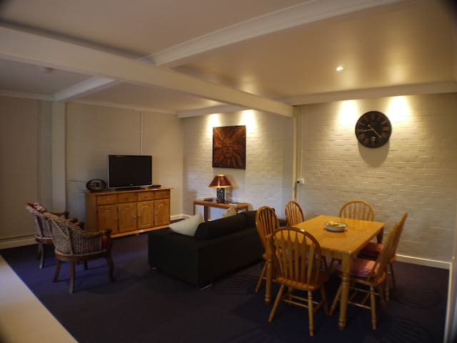 Spacious lounge and dining area. Free WiFi, TV and radio.