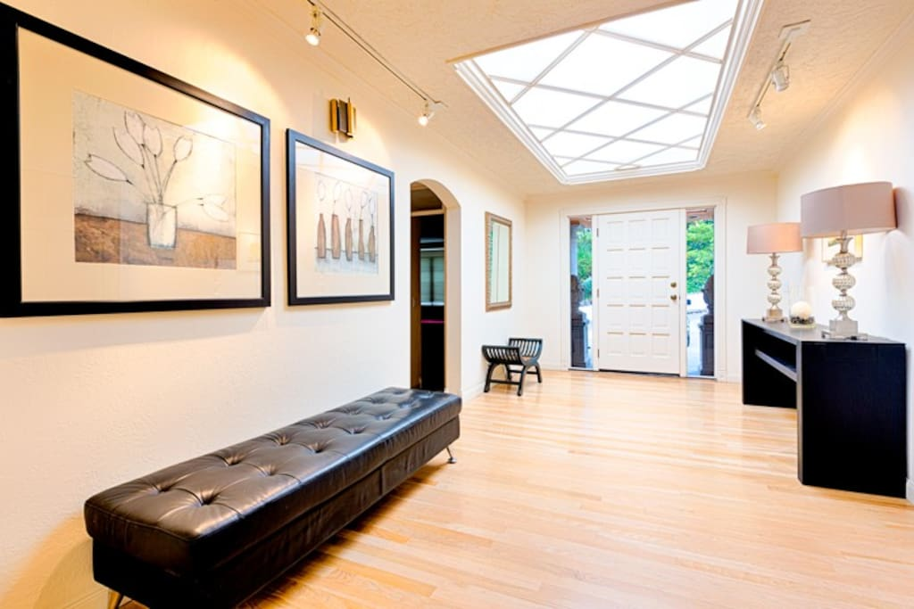 Step into the foyer with skylights and graceful decor