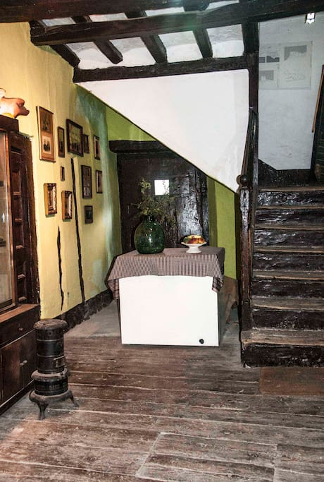 Typical entrance of a village house in the Pyrenees. Parquet floor wood of three centuries ago. Access to the room is rented