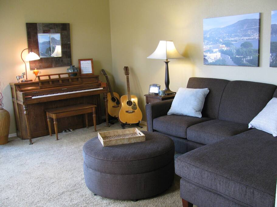 Living room with city and hill views