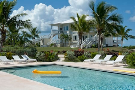 New Condo w/ Htd Pool, Private Beach, Dock, 2-Ocean View, Golf Cart, Kayaks