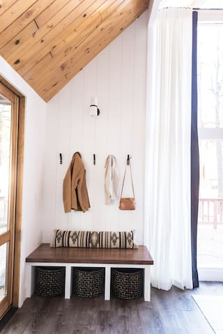 Entry way. Coat hooks, shoe baskets