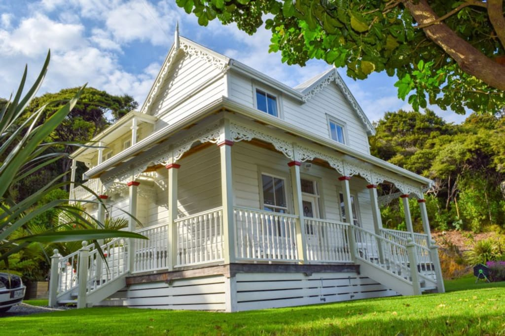This is Oke Bay Lodge. It's an historic homestead, 120 years old, and made entirely of Kauri.  It is charming beyond belief and nearly everyone who stays comments about the incredible peace they feel living here. Try it and see!