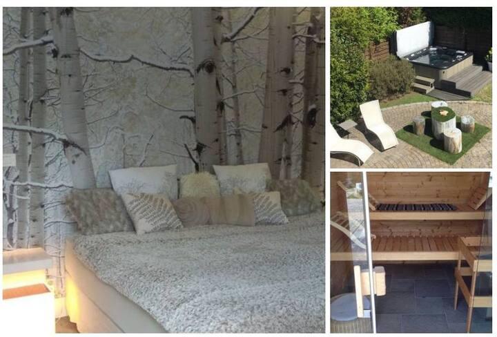 Studio de luxe avec Jacuzzi et Sauna privatifs