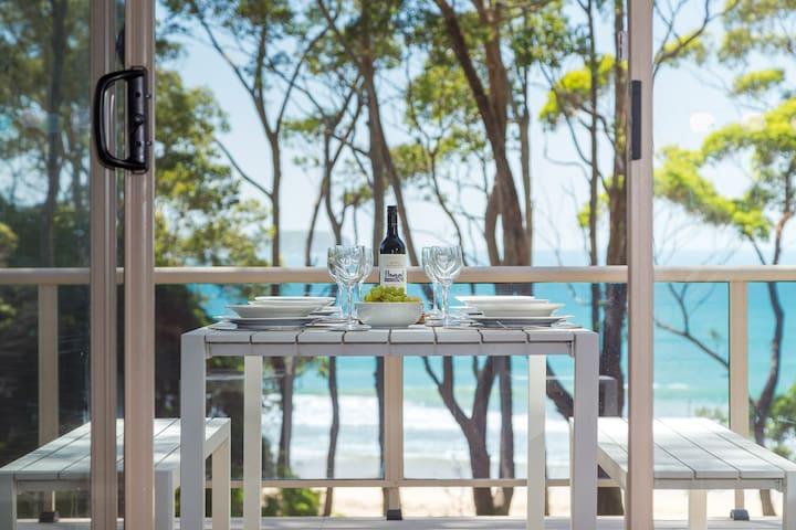 Dining on the balcony overlooking Denhams Beach