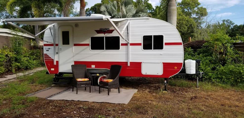 Charming camper in tropical yard