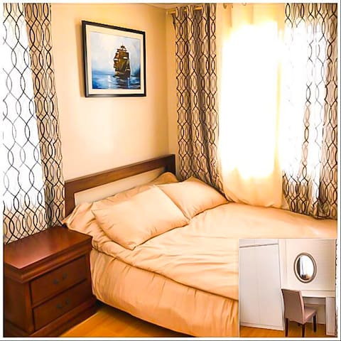 Spacious airconditioned bedroom with extra double floor mattress, accommodates 2-4 guests