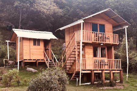 Wooden cabin in the woods Farallones de Sutatausa