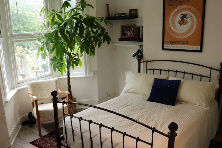 Bright, roomy double bedroom in rare London oasis