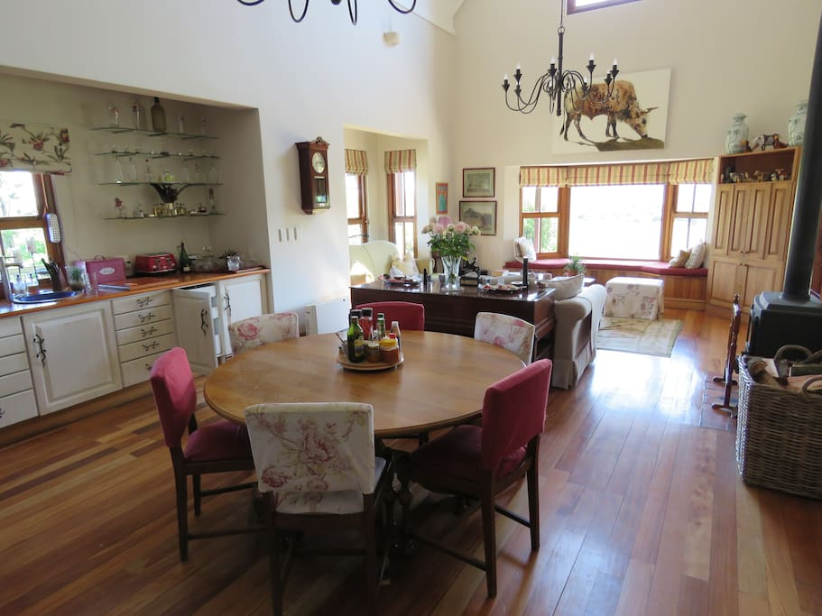 The living area which includes hob/oven, dining area, sitting area and TV