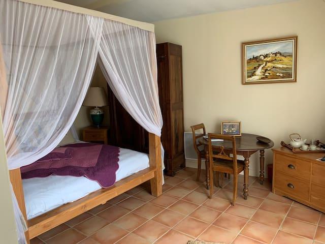 Chambre avec lit  balinais à baldaquin