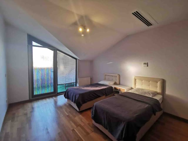 bedroom 3( has two single beds and we added one large double bed )