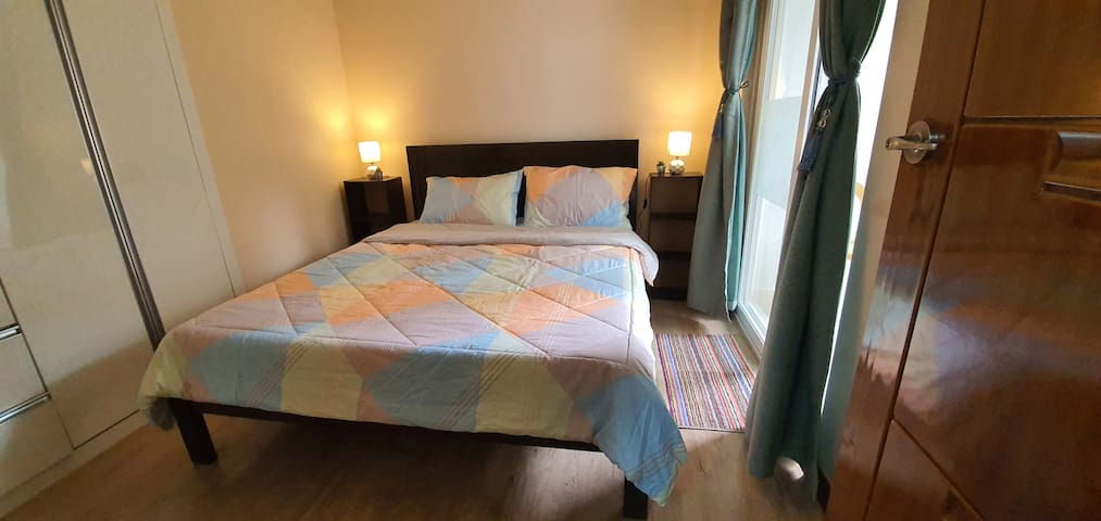Queen-size bed in main bedroom can comfortably accomodate 2 persons.