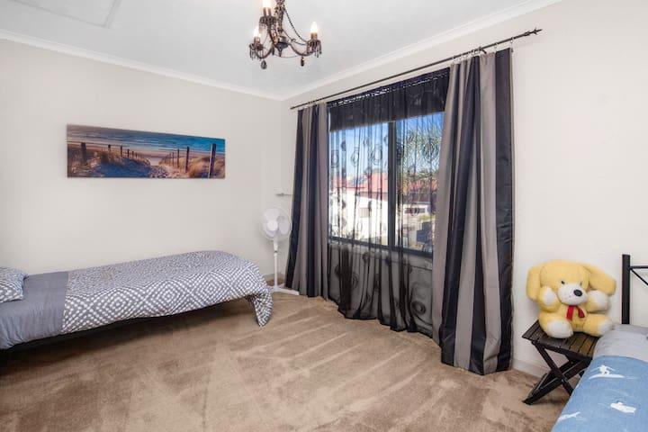 Bedroom 4, 2 single beds.